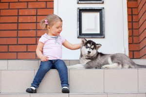 bigstock-Child-with-a-dog-on-the-porch-21335915